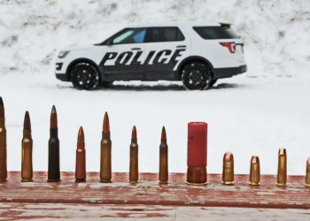 In this March 3, 2016, photo provided by Ford Motor Company, different types of ammunition used in testing are displayed, foreground, as a Ford Police Interceptor Utility vehicle sits parked in the background during ballistic testing of doors against small arm fire at the Livingston Conservation and Sports Association in Brighton, Mich. Ford will soon be offering doors on its Police Interceptor sedans and SUVs that can protect against armor-piercing bullets. They'll be the first in the U.S. to meet the Justice Department's highest standard for body armor, the equivalent of a bulky SWAT team vest. (Ryan Koehler/Ford Motor Company via AP) MANDATORY CREDIT