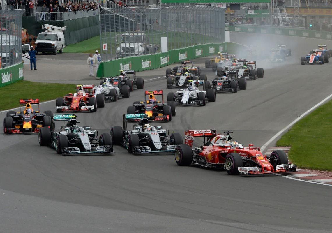 Vettel aproveitou-se da briga em casa para assumir a liderança na largada (Foto Ferrari