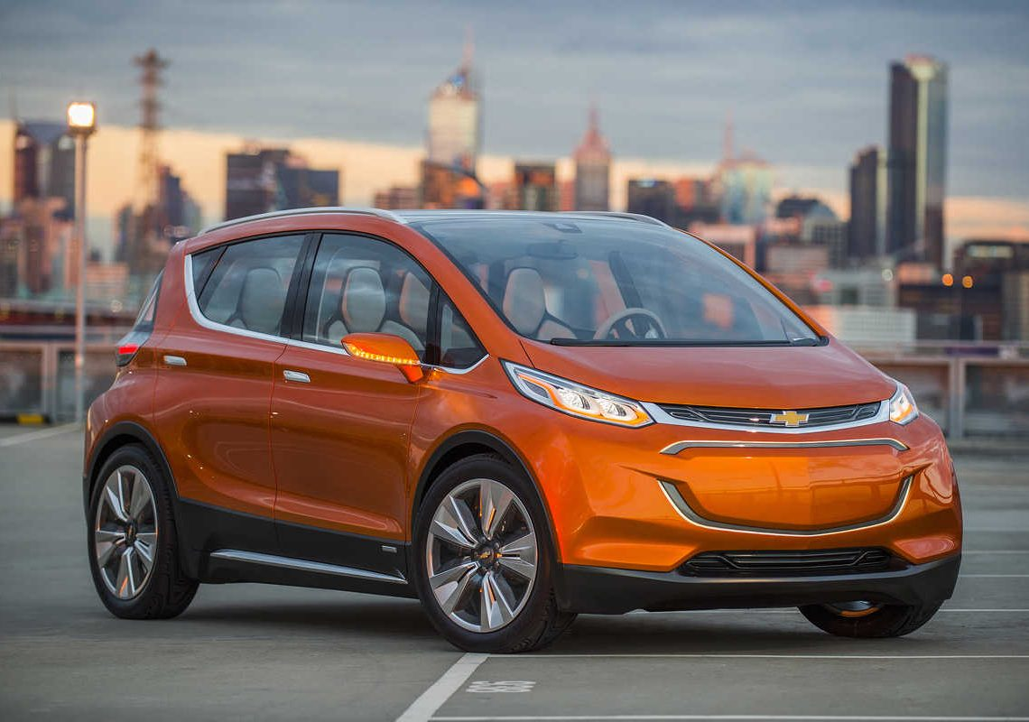 2015 Chevrolet Bolt EV Concept all electric vehicle. Front ¾ in city scape. Bolt EV Concept builds upon Chevy's experience gained from both the Volt and Spark EV to make an affordable, long-range all-electric vehicle to market. The Bolt EV is designed to meet the daily driving needs of Chevrolet customers around the globe with more than 200 miles of range and a price tag around $30,000.